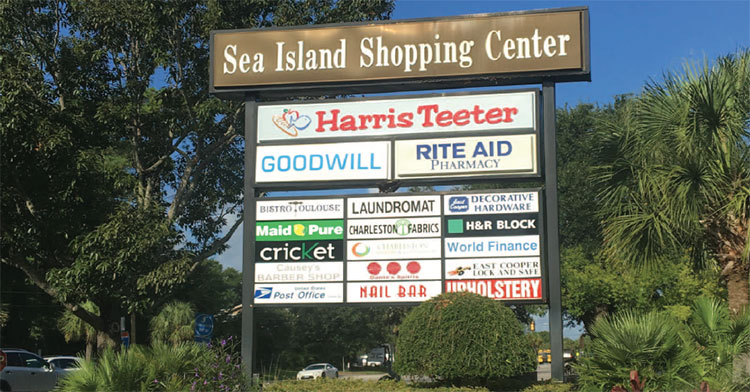 Sea Island shopping Center signs show the center's businesses